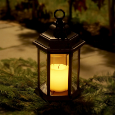Battery operated lantern with twilight sensor